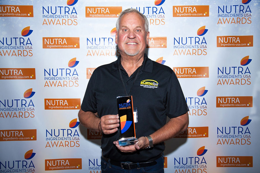 Mark LeDoux, NAI CEO & Chairman, proudly accepts CarnoSyn®'s Sports Nutrition Ingredient of the Year award.